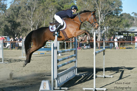 Gemma competing in the 1.20m class on KING at the NSW Interschool Champs 2014.